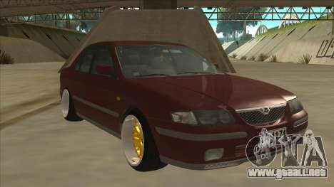 Mazda 626 Hellaflush para GTA San Andreas left