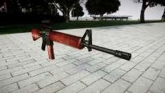 El rifle M16A2 [óptica] rojo