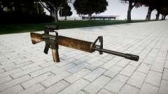 El rifle M16A2 [óptica] polvo